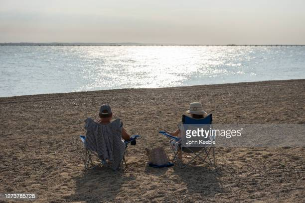 A couple sit on the beach in the late afternoon during the recent warm weather on September 20 2020 in Southend on Sea London