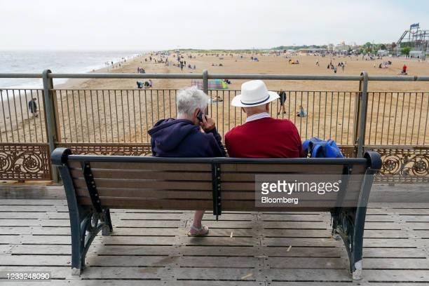 Couple sit on the pier overlooking the beach in Skegness, U.K., on Monday, May 31, 2021 .U.K. Health SecretaryMatt Hancocksaid people who want to go...