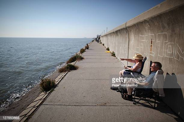 A couple sit on the sea front on September 29 2011 in Canvey Island England Much of the United Kingdom is enjoying a late spell of hot weather which...