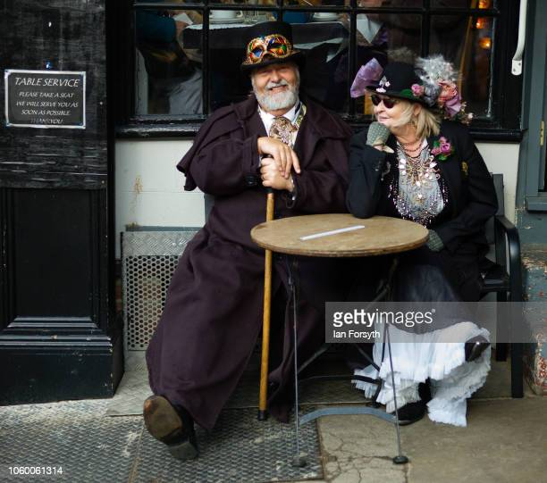 A couple sit outside a cafe as they attend Whitby goth Weekend on October 27 2018 in Whitby England The Whitby goth weekend began in 1994 and takes...