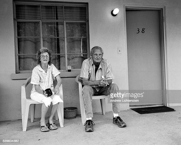 A couple sit outside of their motel room in Cherokee North Carolina on the Cherokee Indian Reservation Many tourists come to visit the area to gamble...