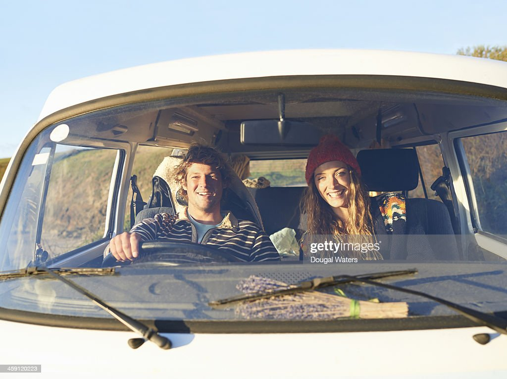 Couple siting in camper van. : Stock Photo