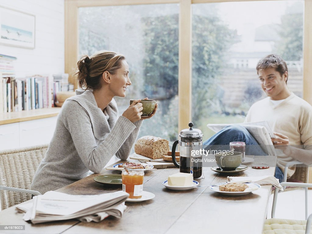 Couple Sits at a Table Over Breakfast : Stock Photo
