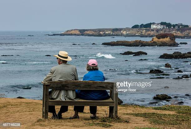 A couple sits on a bench overlooking the ocean during the annual Winesong event held at the Botanical Garden on September 6 near Fort Bragg...
