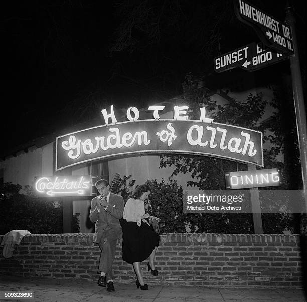 A couple sits outside the Garden of Allah hotel on Sunset and Havenhurst in Los AngelesCalifornia