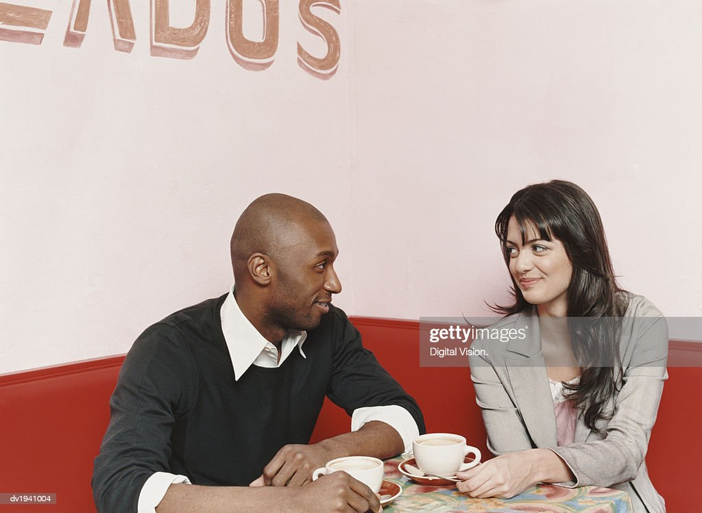 Couple Sitting at a Table in a Cafe : Stock Photo