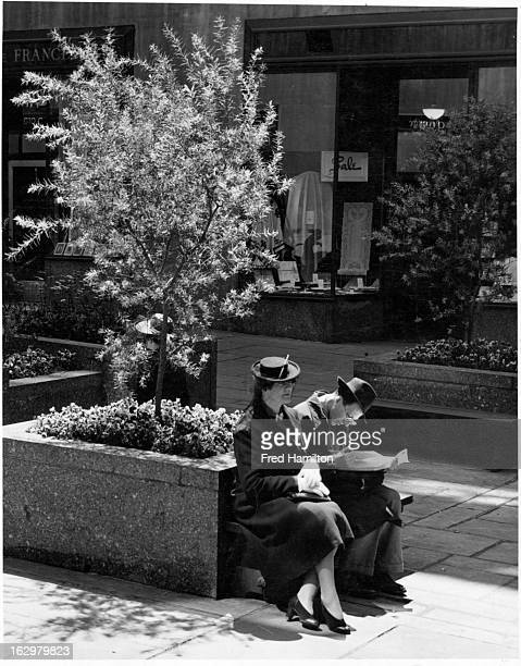 Couple sitting at Rockefeller Center in New York City, New York, circa 1939.