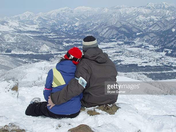 Couple sitting at ski resort