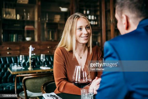 couple sitting at table in restaurant for lunch - berlin stock pictures, royalty-free photos & images
