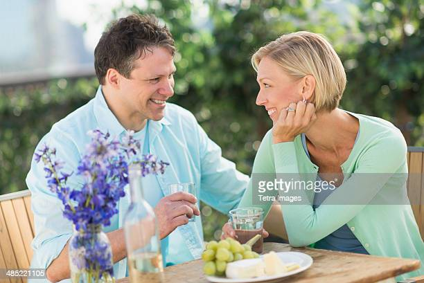 Couple sitting at table outdoors