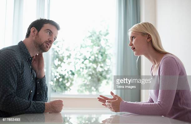 Couple sitting at table, talking