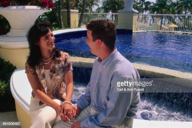 Couple Sitting by Fountain