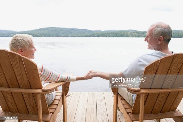 couple sitting by lake - corbis images stock photos and pictures