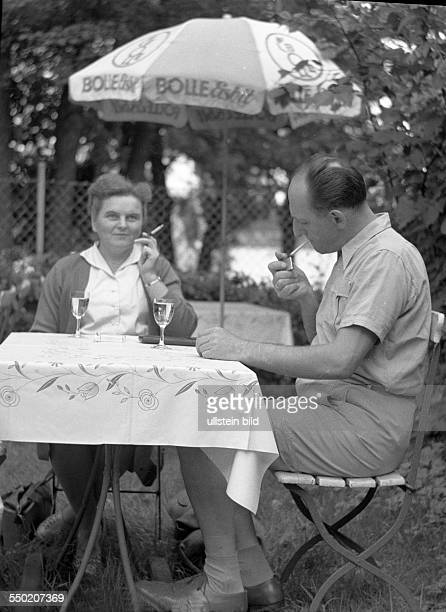 Couple sitting in a beer garden at Bolle smoking and drinking