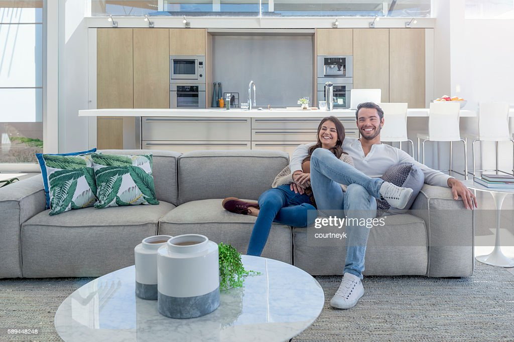 Couple sitting in a modern open plan house. : Foto de stock