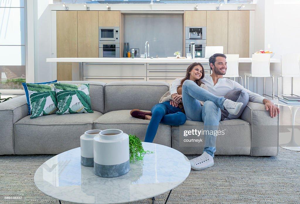 Couple sitting in a modern open plan house. : Foto de stock