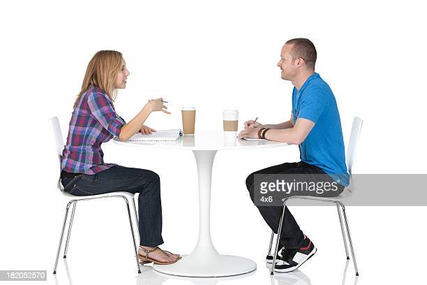 couple sitting in a restaurant - sitting stock pictures, royalty-free photos & images