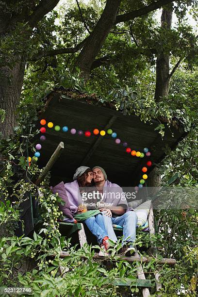 Couple Sitting in a Secluded Hut