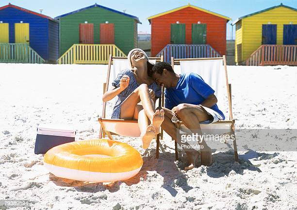 Couple sitting in beach chairs on beach
