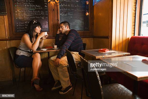 Couple sitting in cafe drinking coffee