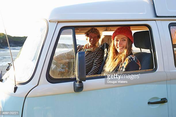Couple sitting in camper van.