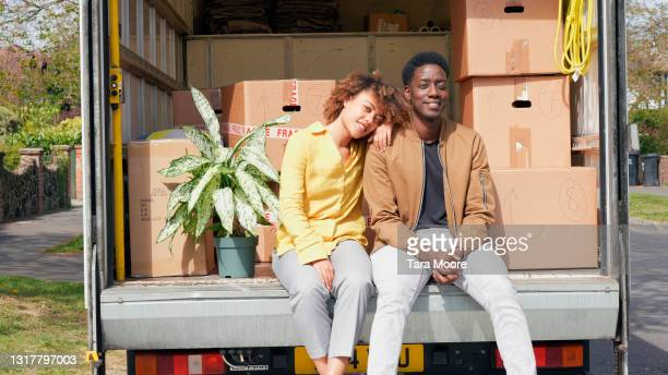 couple sitting in delivery van - human joint stock pictures, royalty-free photos & images