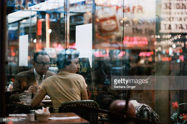 Couple sitting in diner