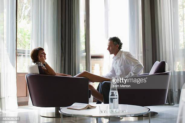 Couple sitting in hotel room