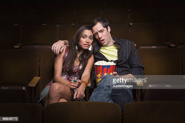 Couple sitting in movie theatre