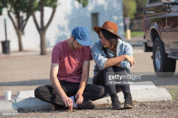 Couple sitting in parking lot