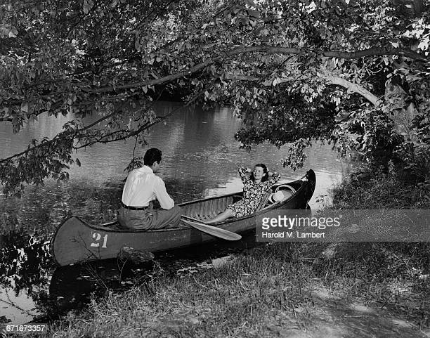couple sitting in rowboat - number of people stock pictures, royalty-free photos & images