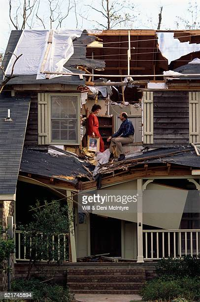 Couple Sitting in Their Damaged House