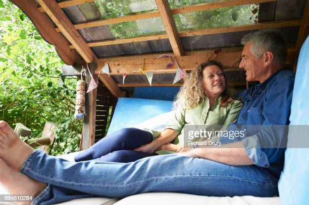 Couple sitting in treehouse
