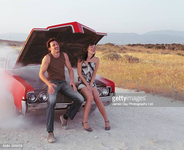 couple sitting on automobile - short skirts in cars stock photos and pictures