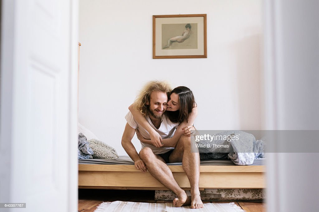 Couple sitting on Bed Hugging : Photo