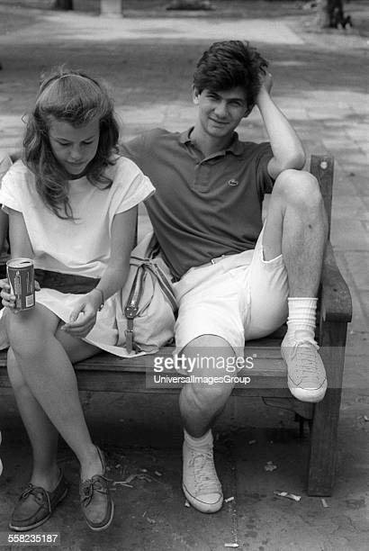 Couple sitting on bench. London, 1980s.