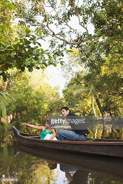 Couple sitting on boat, India