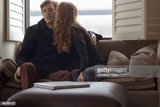 couple sitting on couch - jessamyn harris stock pictures, royalty-free photos & images