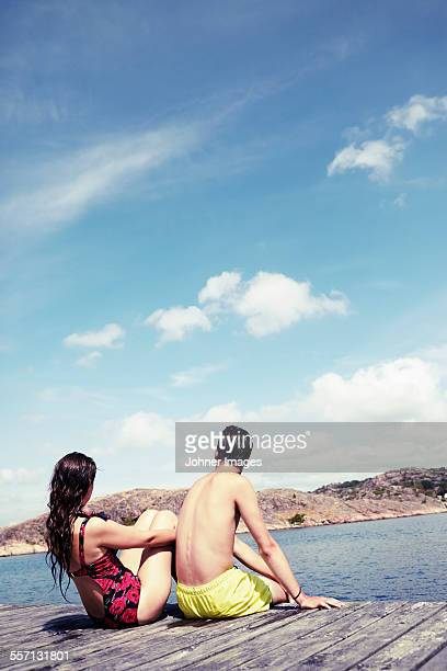Couple sitting on jetty