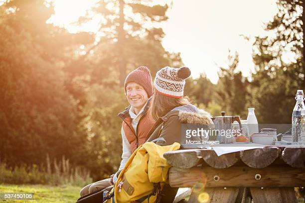 couple sitting on outdoor table - mid adult men stock pictures, royalty-free photos & images