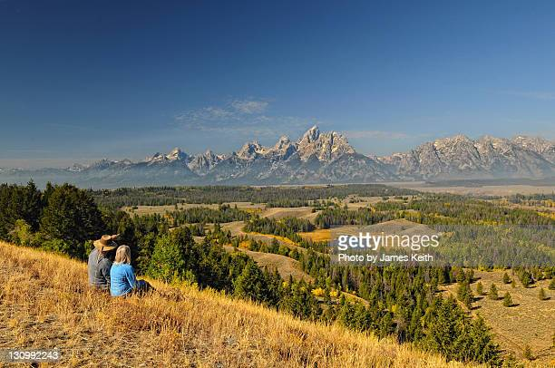 couple sitting on ridge - jackson hole stock pictures, royalty-free photos & images