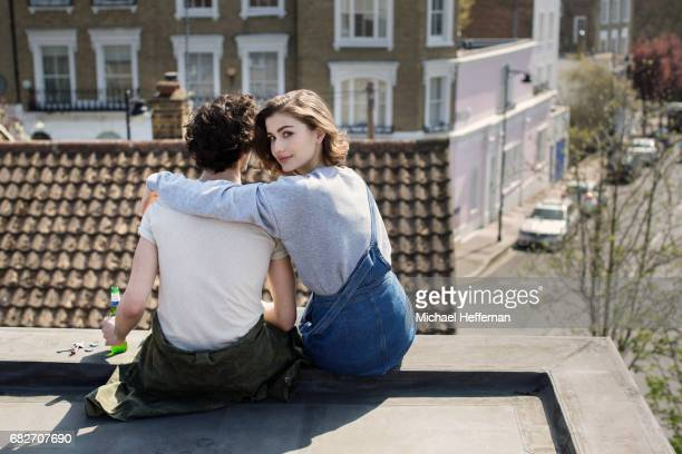 Couple sitting on roof