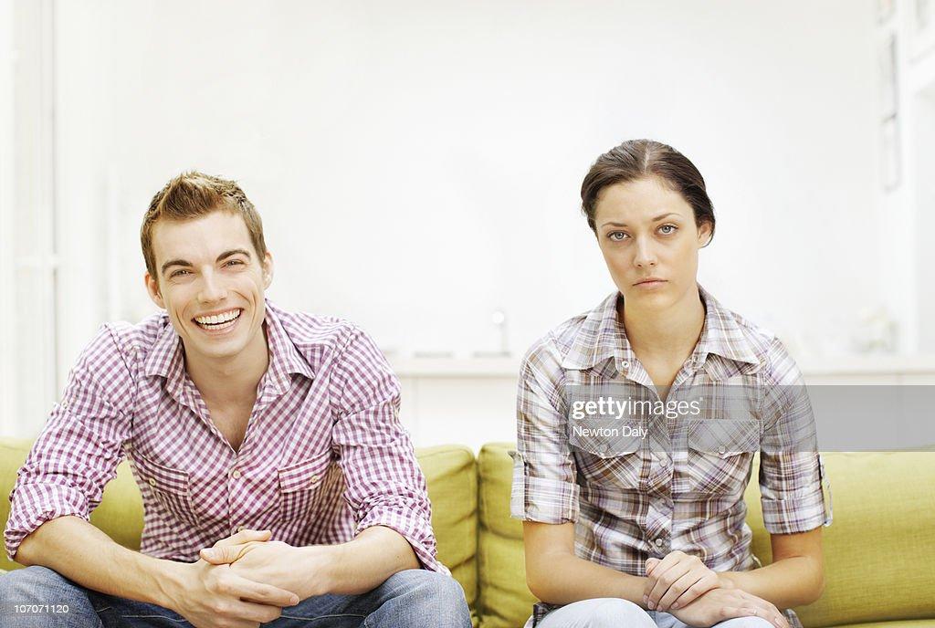 Couple sitting on sofa : Stock Photo