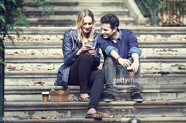Couple sitting on steps