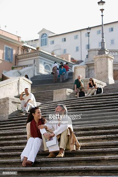 Couple sitting on stone steps
