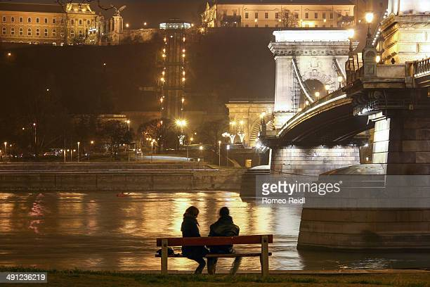 Couple sitting on the bench at the Chain bridge