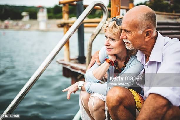 couple sitting on the jetty relaxing