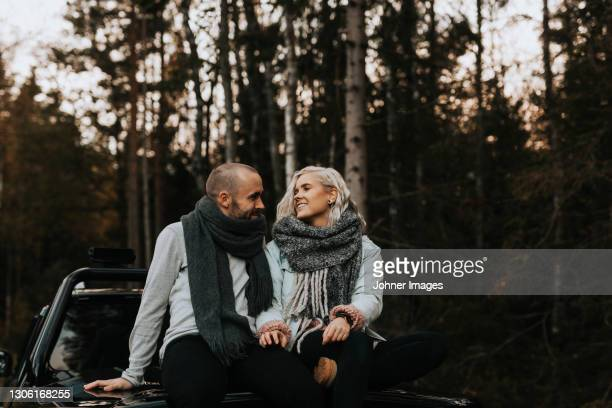 couple sitting on top of pick up truck - västra götaland county stock pictures, royalty-free photos & images