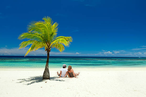 Couple sitting on tropical beach