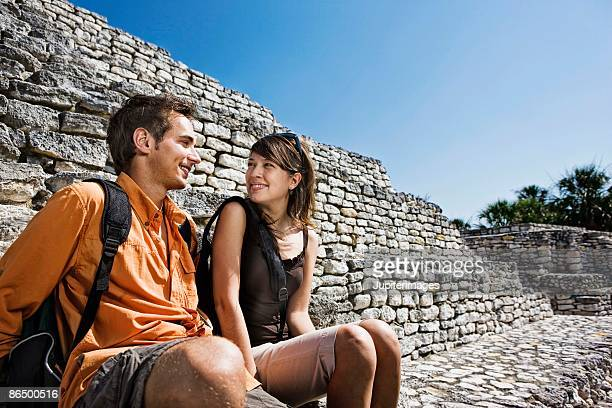 couple sitting on tulum ruins, quintana roo, mexico - old ruin stock pictures, royalty-free photos & images